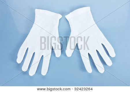cloth gloves on blue background