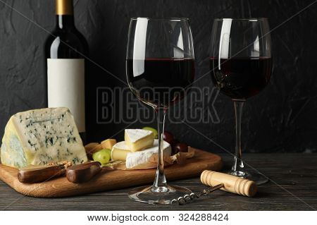 Cheese, Grape, Bottle And Glasses With Wine On Wooden Background. Wine Tasting