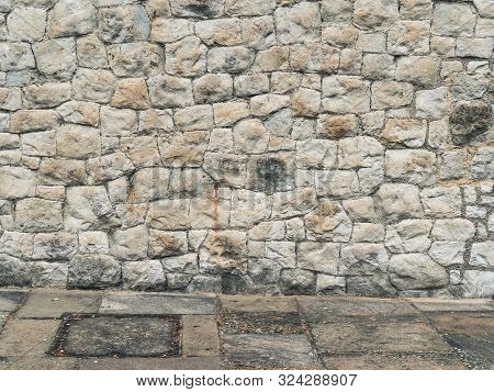 Abstract Empty Urban Exterior Background With Cobble Wall And Concrete Floor Tiling. Medieval Stone