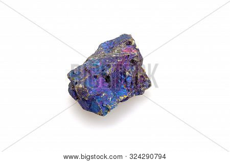 Mineral Chalcopyrite On A White Background. Copper Pyrite. Multi-colored Natural Stone. Nugget Close