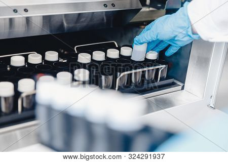 Medical Professional Places Samples In Sperm Bank For Storage And Analysis. Concept Cloning