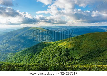 Summer Afternoon In Mountains. Wonderful Landscape Of Green Carpathian. Beautiful Fluffy Clouds On A