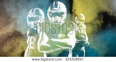 American Football Player against digitally generated image of color powder