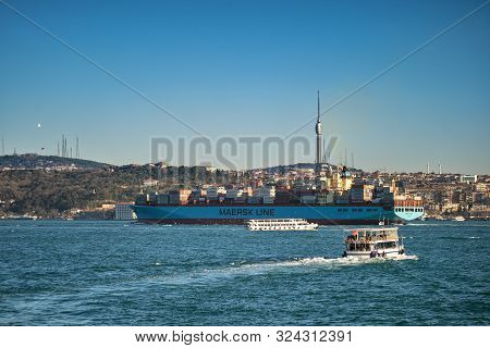 A Huge Container Ship, Maersk Line, Passes Through The Bosphorus In Front Of The Asian Side Of Istan