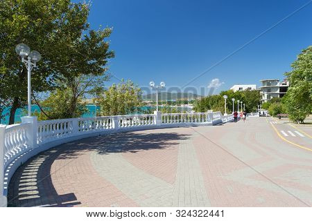 View On White Stone Fence With Balusters From Sea Promenade On Sunny Early Autumn Day In Velvet Seas