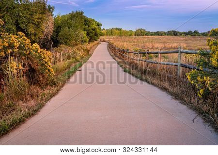 early fall dusk over a bike trail -  multi uae Poudre River Trail in northern Colorado