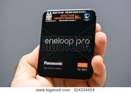 Paris, France - Sep 13, 2019: Man Hand Holding Panasonic Eneloop Pro High Capacity Modern Ni-mh Batt