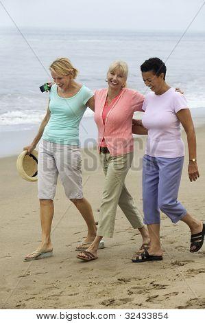 Women Walking Beach Together