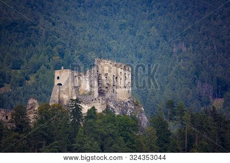 View On Ruins Of Ancient Castle  Likava Among The Forest. Liptov Region. Slovakia.  Tourist Attracti