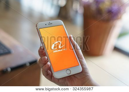 Chiang Mai, Thailand - Apr.27,2019: Woman Holding Apple Iphone 6s With Alibaba Apps On Screen.alibab
