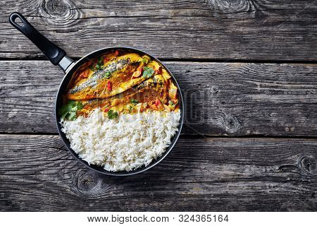 Yellow Curry, Panang Curry With Grilled Saba Mackerel Fish Served With Steamed Long Grain Rice In A