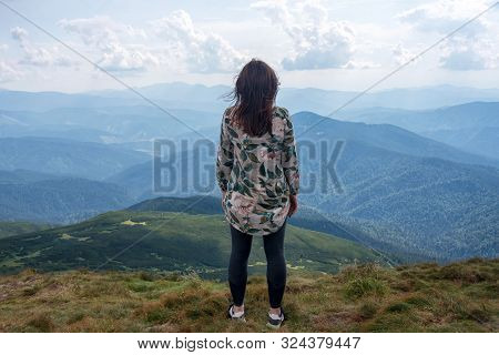 Girl Traveling In Mountains Alone, Calm Scene. Walking Outdoors, Woman Hiker On Mountain Top. Back V