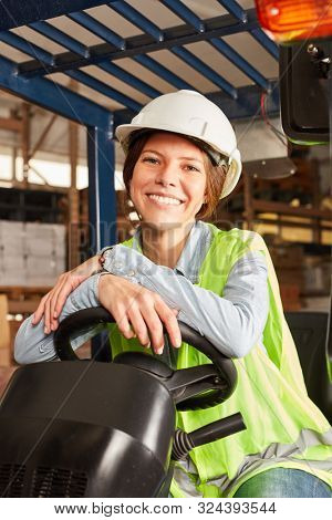 Young logistics. Woman on the forklift in training to the forklift driver