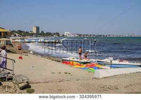 Feodosia, Crimea, Russia - September 11, 2019: Feodosia Central Beach. Autumn In The Resort Town.