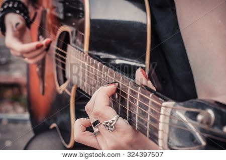 Girl In Punk Rock Style Plays The Acoustic Guitar, Street Culture Concept