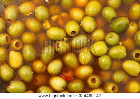 Pickled Green Olives With Hot Chili Peppers Garlic Marinated In Spicy Brine At Farmers Market. Artis