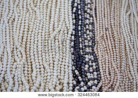 Two Mixed Strands Of Natural Black Pearl Beads. Together With White Pearl Beads