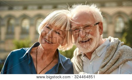 I Am Gonna Love You All My Life. Happy Senior Couple Smiling While Spending Time Together Outdoors