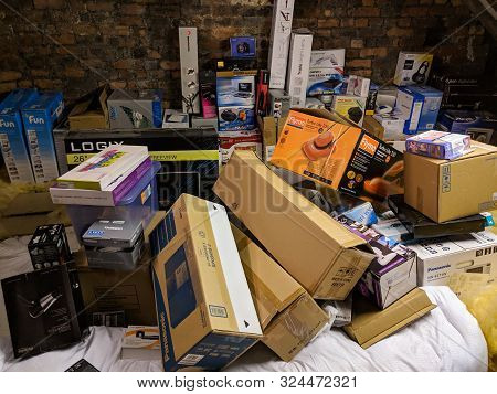 Wrexham, Uk - January 24, 2019: Various Appliance And Product Boxes Stored In A Home Attic. Disorgan