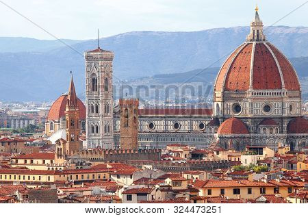 Tuscany Landscape With Ancient Bell Tower Of Giotto And The Cathedral With Huge Dome Of Florence In