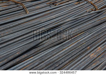 Industrial background. Brand new steel rebars. Preparation for pouring concrete. Construction of buildings of reinforced concrete. poster