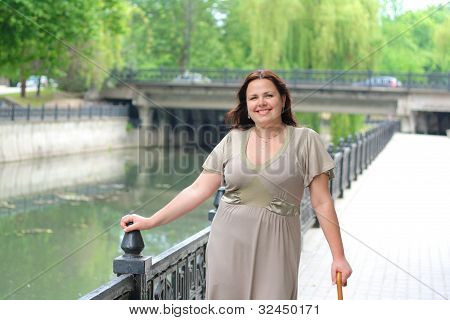 young plump girl walks in the park