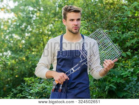 Barbecuing Meat On Grill. Culinary. Chef Cooking Bbq Food. Tools For Roasting Meat Outdoors. Man Bar