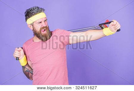 Man Bearded Athlete Exercising With Expander Equipment. Try Stretching Exercise. Athlete Sport Instr