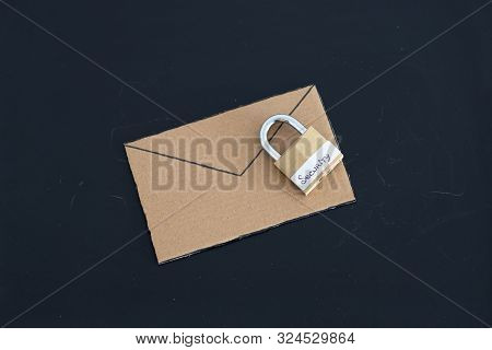 User Privacy Concept, Email Envelope Miniature On Desk With Lock Labelled Security On It
