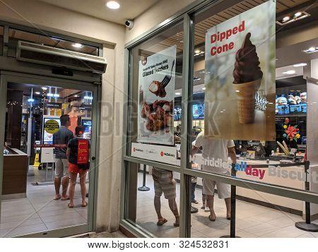 Waikiki- August 26, 2018: Mcdonalds Store Entrance With Ads For Food On Glass Windows In Waikiki, Ha