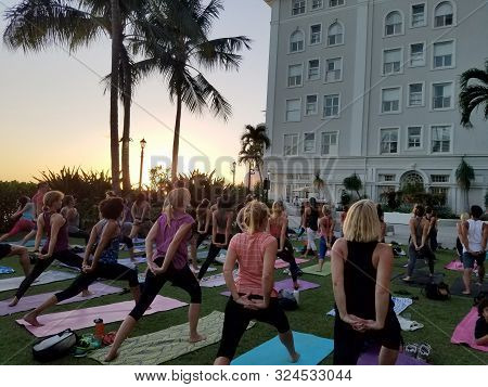 Waikiki - September 19, 2017: Large Group Of People Do Yoga At  Vino And Vinyasa Event Hosted By The