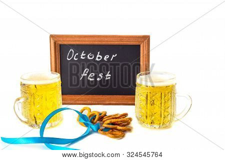 Octoberfest Concept. Beer Mug With Snacks Of Salt Pritzels, Bretzel And A Board With The Words