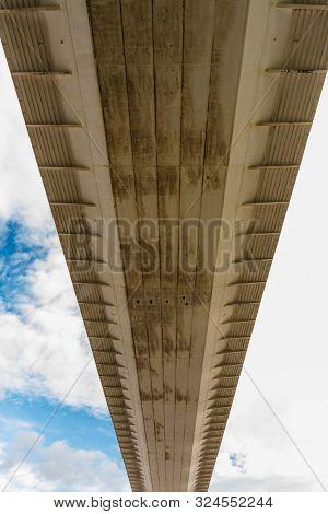 Underside Of Large Road Suspension Bridge, Portrait, Zoom.