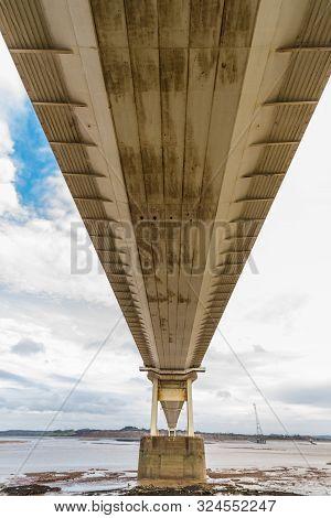 Underside Of Large Road Suspension Bridge, Portrait.