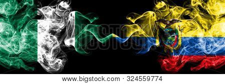 Nigeria Vs Ecuador, Ecuadorian Abstract Smoky Mystic Flags Placed Side By Side. Thick Colored Silky