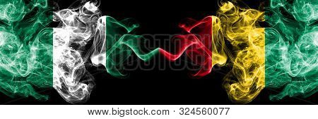 Nigeria Vs Guinea, Guinean Abstract Smoky Mystic Flags Placed Side By Side. Thick Colored Silky Smok