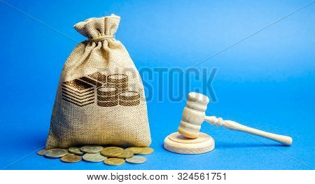Money Bag And Judge's Hammer. Penalty For A Crime And Offense. Financial Punishment. Violations Of T
