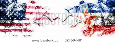 United States Of America Vs Yugoslavia Smoky Mystic Flags Placed Side By Side. Thick Colored Silky A