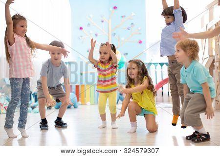 Preschool Children Group In Day Care Centre. Active Games For Kindergarten Kids