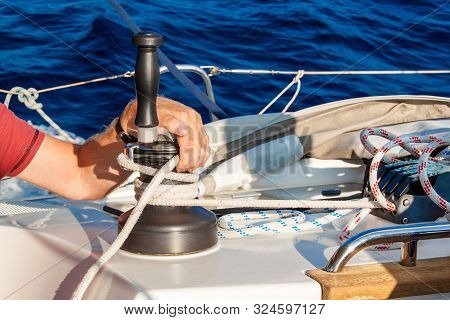 Sailboat Winch And Rope Yacht Detail. Yachting. Sailing On The Sea. Close Up On Yacht Cord Crank, Ya