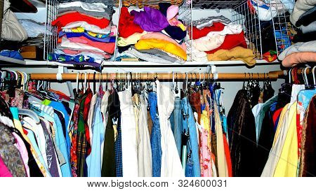 Overcrowded closet for a female user indoors. poster