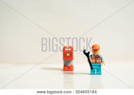 Monterrey Mexico, Sept 26 2019: Studio Shot Of Lego People. Construction Worker With Mailbox And Saf