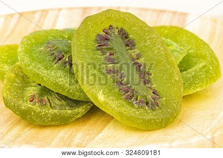 Dehydrated (dried) Sliced Natural Green Wiki On Wooden Plate Closed-up