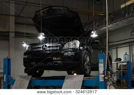 Novosibirsk, Russia - 08.01.2018: Used Black Car Mercedes Benz Gl With An Open Hood Raised On A Four