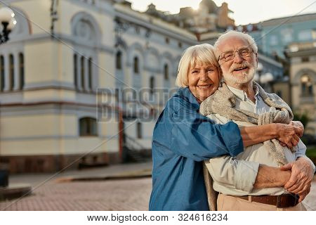 True Love Has No Expiration Date. Portrait Of Cheerful Senior Couple In Casual Clothing Embracing Ea