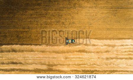 Harvester Machine Working In Field . Combine Harvester Agriculture Machine Harvesting Golden Ripe Wh