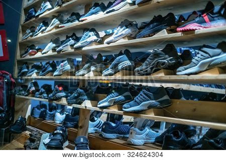 Batumi, Georgia - July 4 2019: Many Different Sneakers On Display Through The Glass. Image Of Sports
