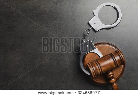 Judge's Gavel And Handcuffs On Grey Background, Flat Lay With Space For Text. Criminal Law Concept