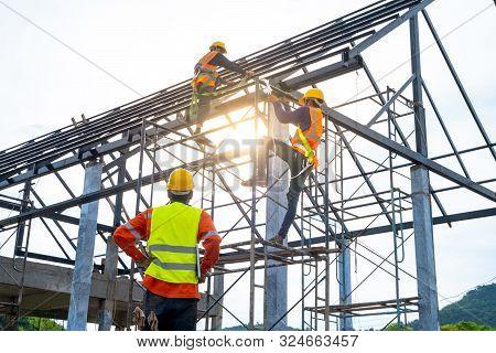 Engineer Technician Watching Team Of Workers On High Steel Platform,engineer Technician Looking Up A