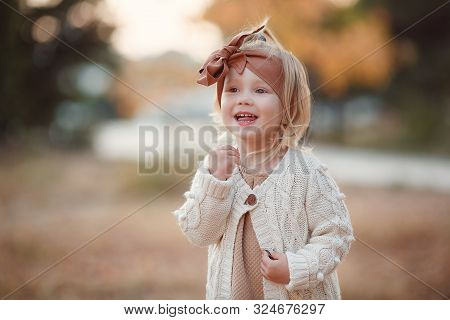 Little Fashionista. Happy Girl On Autumn Day. Little Girl Happy Smiling With Autumn Leaves. Girls Au